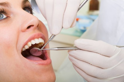 Patient getting dental implant check up